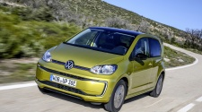 VW e-Up! driving in metallic Honey Yellow colour