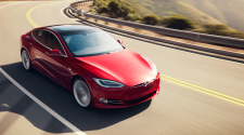 Red Tesla Model S driving